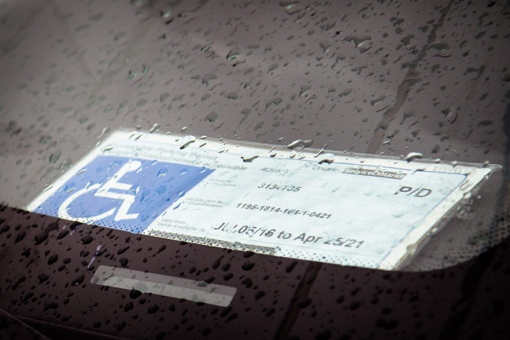 An accessible parking permit sits on the dashboard of a car parked at the Walmart Train Yards Supercentre in Ottawa.