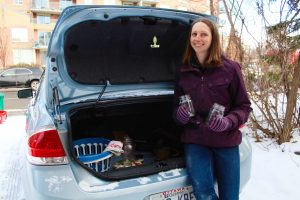 """Jodi Wilson in front of her car before going to do the groceries. She lives a """"zero waste"""" lifestyle and has always reusable bags and jars in the back of her car."""