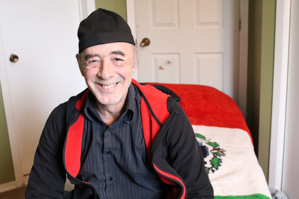 Photo Credit: Megan McPhaden Karol Frimmel Jr., 60, sits on his bed at Maison Crossroads, a federal halfway house that offers services targeted to older offenders.